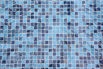 blue tiled swimming pool background with reflection