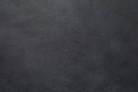 Black stone or slate texture background