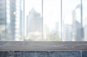 Stone table top and blur glass window wall building background - can used for display or montage your products.