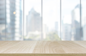 Wood table top and blur glass window wall building background - can used for display or montage your products.