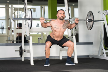 Man Doing Heavy Weight Exercise With Barbell