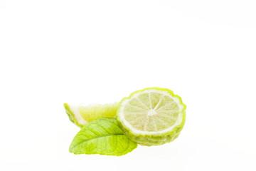 Bergamot fruit and leaves isolated on white background.