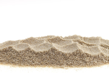 Pile of sand isolated on white background.
