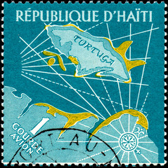 UKRAINE - CIRCA 2017: A postage stamp printed in Haiti shows Map of Tortuga Island, from the series Tourism. History of Tortuga Island, circa 1961