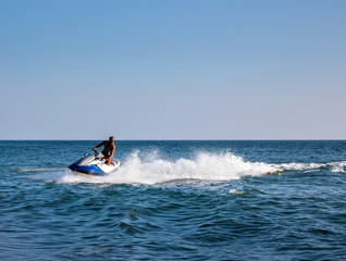 Garden Poster Water Motor sports Silhouette of man on jetski at sea