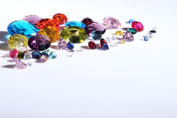 Colorful of different gemstones with space for text on white background.