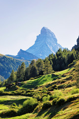 Matterhorn mountain and valley with chalets of Switzerland