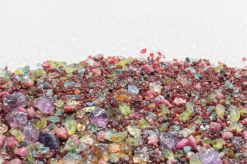 Colorful stones background - pile of semi precious jewelery stones