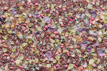 Colorful stones background - pile of semi precious jewelery stones