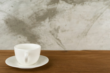 cup, coffee cup on table wood behind blur concrete