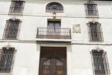 Old iron window with wooden edges on a Spanish street. Traditional architecture in spain