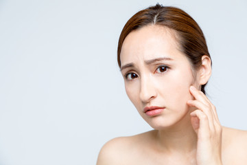 beauty girl who checks her skin, skin care, acne treatment