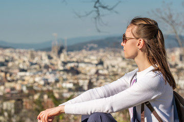 Woman overlooking Barcelona cityscape from Montjuic