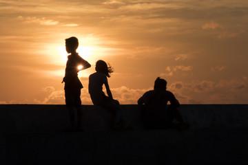 Silhouette people acting and sunset background at Bangpu Samutprakarn province dated 15.04.2017