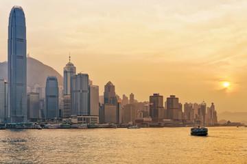 Star ferry at Victoria Harbor in Hong Kong at sundown