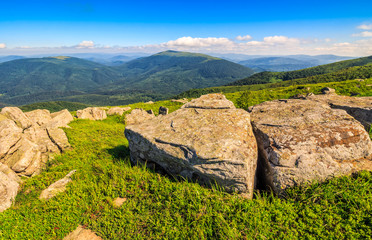 huge stones on the meadow on top of mountain ridge