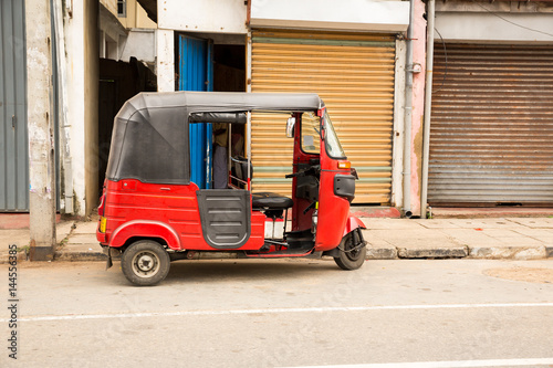 tuk tuk on road of sri lanka side view stockfotos und. Black Bedroom Furniture Sets. Home Design Ideas