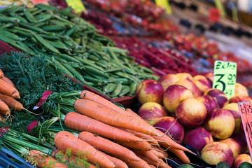 Fresh carrots in assortment on market