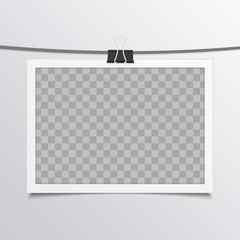 Photo frame on rope.