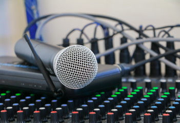 Close up of  microphone on sound mixer covered in dust