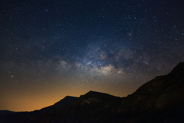 Milky way galaxy with stars over moutain, Long exposure photograph, with grain.