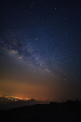 Milky way galaxy at Phutabberk Phetchabun in Thailand.Long exposure photograph.With grain