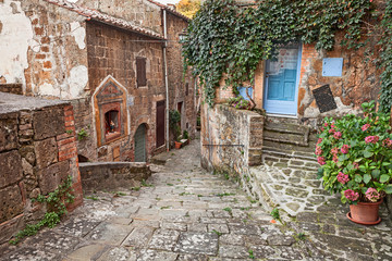 Fototapeta Sorano, Grosseto, Tuscany, Italy: alley in the old town