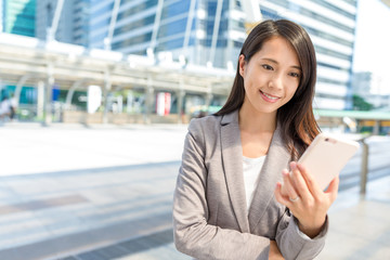 Businesswoman use of mobile phone in Bangkok city