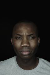 Portrait of hurt afro-american man