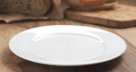 empty white plate on wood table for your dish, 4k photo