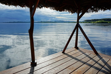 Peaceful view from a tropical hut over the sea with islands at the horizon, archipelago of Bocas del Toro, Caribbean, Panama