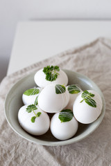 Easter eggs Decorated with leaves on textile background. Concept for your design