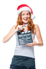 A young actress with a beater of cinema wears a Santa hat