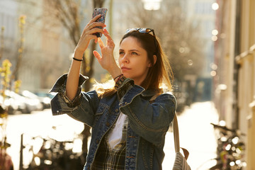 A girl making selfie on a street