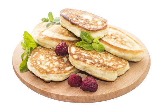 Cheese pancakes on wooden board