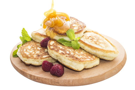 Cheese pancakes with raspberries and honey