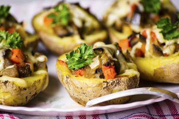 Baked potatoes stuffed with vegetables and cheese