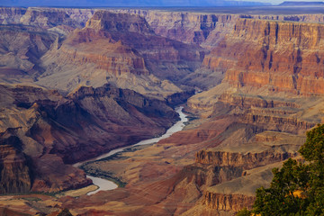 Grand Canyon at the sunset with colorful cliffs, Colorado river