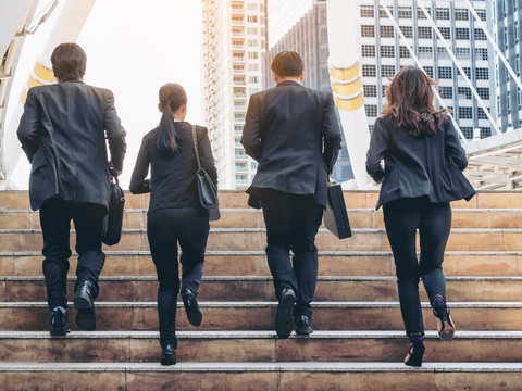 Group of Business People Running in Row