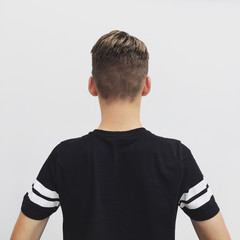 Rear view of a boy with a new haircut