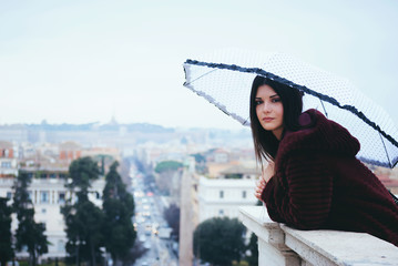 Beautiful young girl watching the panoramic view of Rome from the terrace