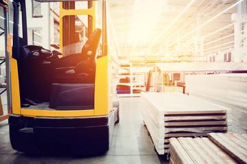 Building materials warehouse, logistics concept, construction of houses, loader.