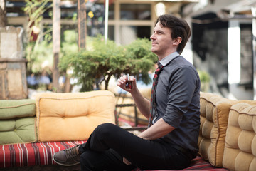 Man sitting in garden with a cup of tea