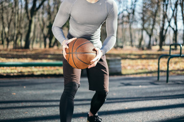 Man playing basketball in park, Minsk, Belarus