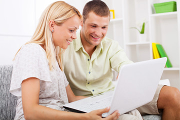 Young couple using laptop.