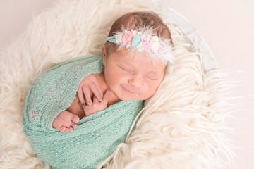 Aorable cute baby smiling in sleep, closeup