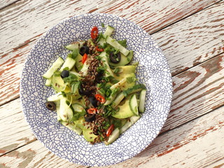 Vegetarian salad of avocado, cucumber and olives