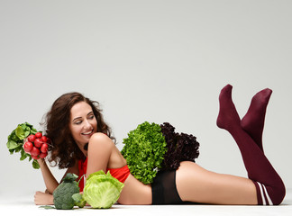 Dieting. Woman hold bunch of radish lettuce broccoli happy smiling