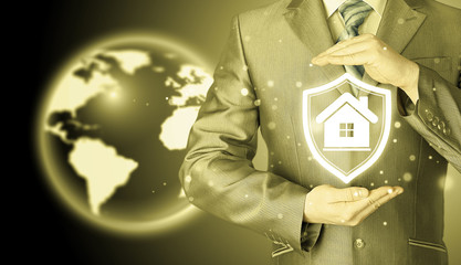 House protection and insurance. Home shield. Real estate safety. Globe background. World wide insurance.