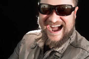 Handsome bearded man in sunglasses emotional portrait